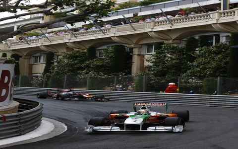 Monte Carlo, Monaco  2010 Vitantonio Liuzzi, Force India VJM03 Mercedes, 10th position, leads Sebastien Buemi, Toro Rosso STR5 Ferrari, 11th position.