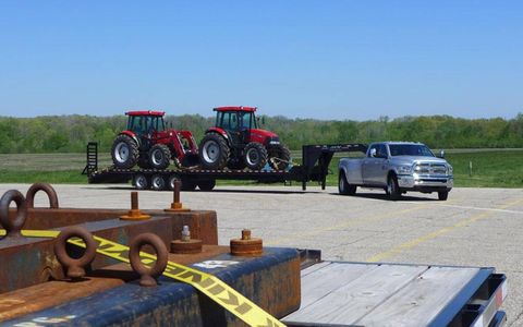 Tow anything -- even two tractors -- with a Ram 3500 Heavy Duty pickup, so long as it weighs 15 tons or less. Just make sure you have a CDL before you do it on public roads.
