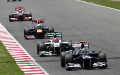 2012 Spanish Grand Prix: Bruno Senna, Williams FW34 Renault, leads Michael Schumacher, Mercedes F1 W03, Sebastian Vettel, Red Bull RB8 Renault, and Jenson Button, McLaren MP4-27 Mercedes.