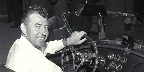 WHEELMAN // Carroll Shelby behind the wheel of the very first Shelby Cobra. Shelby died May 10 at the age of 89. For more photos on Shelby's career, see Carroll Shelby 1923-2012.
