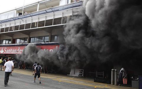 FIRE IN THE HOLE // Smoke bellows from the Williams garage after a fire erupts following the race at Circuit de Catalunya, in Barcelona, Spain. Several crew members were injured in the fire.