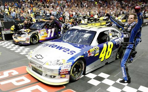 Members of Jimmie Johnson's crew celebrates winning the NASCAR Sprint Pit Crew Challenge at Charlotte, N.C.