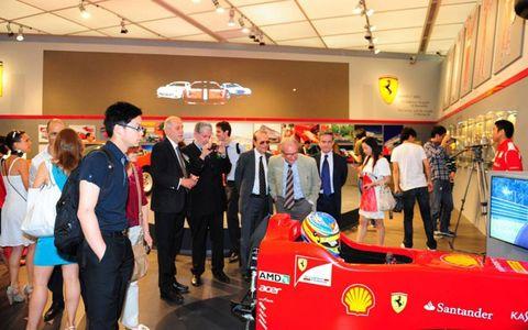 Visitors at the Ferrari Myth Exhibition in Shanghai.