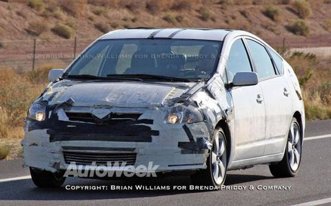 Toyota engineers are testing prototypes of the next-generation Prius hybrid. The new car is slightly larger and has optional solar panels mounted on the roof.