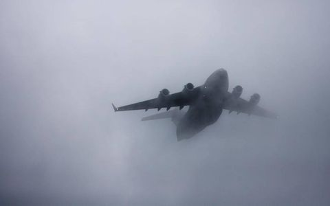 Velvet Fog: A Boeing C-17 Globemaster flys over Dover International Raceway prior to the NASCAR Nationwide Series race on May 14. Photo by Action Sports Photography