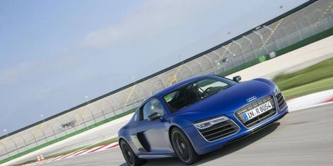 We did not drive this on a race track, as the photo suggests, but that is the 2014 Audi R8 V10 plus Coupe Quattro S tronic in Sepang Blue matte effect paint -- same as ours.