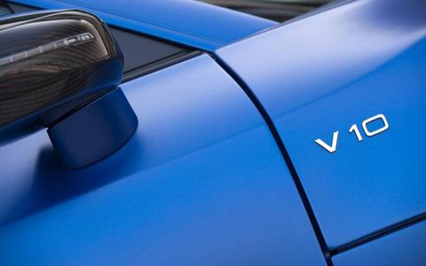 The script is there to remind others that you have the V10 and not the V8 powering your 2014 Audi R8 V10 plus Coupe Quattro S tronic.