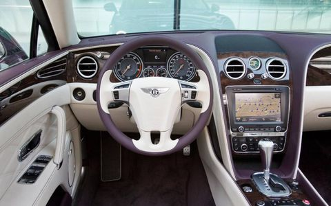 Leather, wood and metal adorn the interior of the 2014 Bentley Flying Spur luxury sedan.