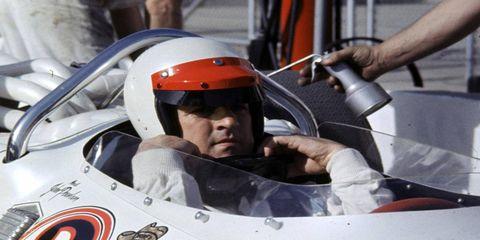 Helmet, Personal protective equipment, Logo, Race car, Windshield, Racing, Motorsport, Auto racing, Automotive window part, Driving,