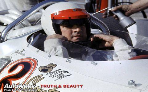 Helmet, Personal protective equipment, Racing, Headgear, Race car, Logo, Open-wheel car, Auto racing, Motorsport, Driving,