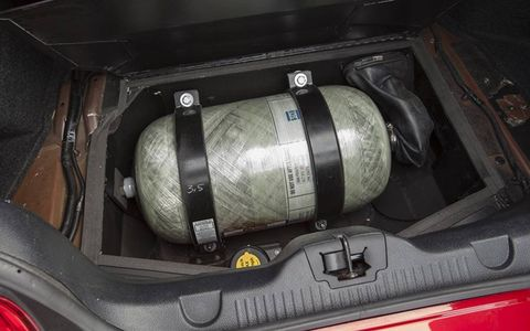 The 2-4 gallon CNG tank in the Mustang goes where the spare tire once went.