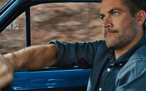 It is no accident that the blue car and blue shirt match those dreamy blue eyes. Go see the movie, ladies, go see the movie. And yes, that's a rhd 1970 Ford Escort.