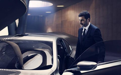 Mr. Gran Lusso pauses for a moment before entering his BMW.