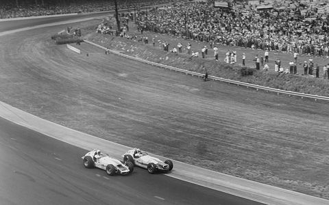 A.J. Foyt's winning Watson (on the outside) battles Parnelli Jone's chassis of the same make in 1964.