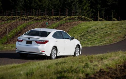 Badges on the rear and sides of the 2013 ES300h indicate its hybrid drive system
