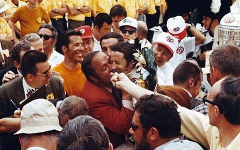 Granatelli gives Mario Andretti a memorable kiss in victory lane after Andretti's 1969 win.