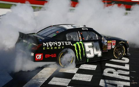 Kyle Busch spins out after winning the Nationwide race in Charlotte on Saturday.