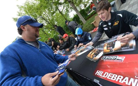 Driver J.R. Hildebrand, right, signs autographs with fellow IndyCar drivers on the eve of the 97th Indianapolis 500.