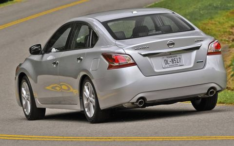 The 2013 Nissan Altima as seen from the rear.