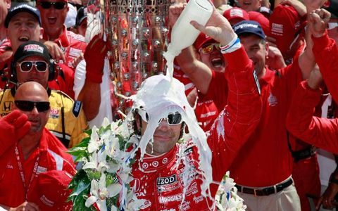 Dario Franchitti takes a milk shower in victory lane at Indianapolis after winning the Indy 500 on Sunday.