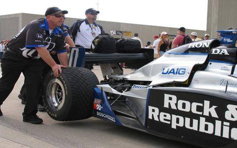 Tire, Automotive tire, Automotive design, Open-wheel car, Automotive wheel system, Automotive exterior, Formula one tyres, Race car, Auto part, Logo,