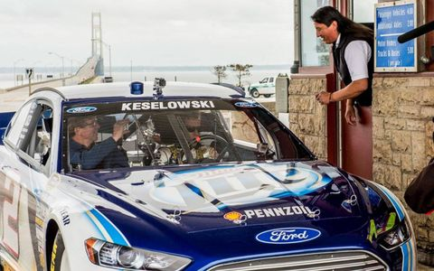 NASCAR champion Brad Keselowski and Michigan International Speedway president Roger Curtis take on the Mackinac Bridge ... and of course pay the toll.