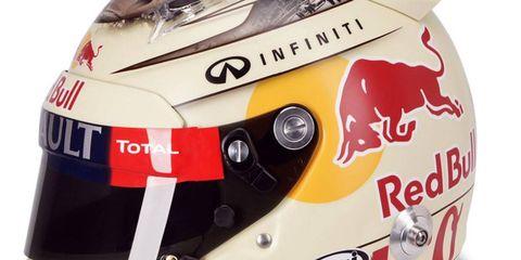 Automotive decal, Personal protective equipment, Logo, Carmine, Motorcycle accessories, Symbol, Race car, Motorcycle helmet, Label, Automotive light bulb,