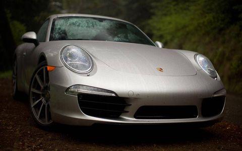 Automotive design, Vehicle, Land vehicle, Car, Rim, Fender, Sports car, Alloy wheel, Performance car, Luxury vehicle,