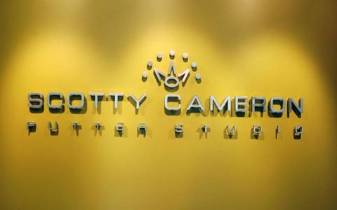 The Scotty Cameron 7-pointed crown logo at the entrance to the Scotty Cameron Putter Studio in San Marcos, California.