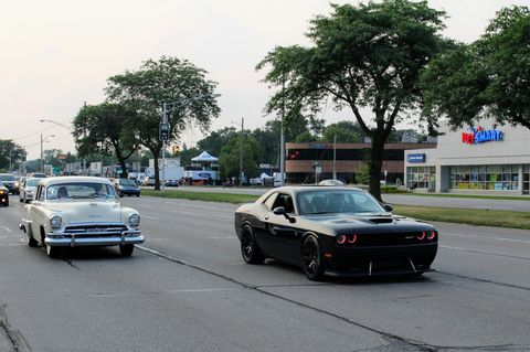 A 1954 Chrysler and Challenger Hellcat share Woodward Avenue.