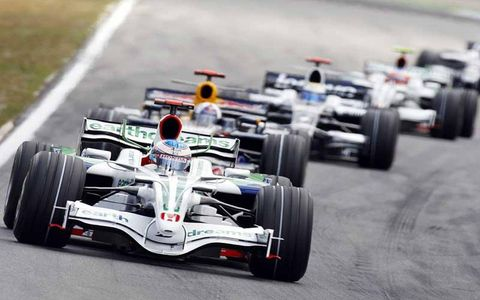 Jenson Button, Honda RA108, 17th position, leads David Coulthard, Red Bull Racing RB4 Renault, 13th position, Nico Rosberg, Williams FW30 Toyota, 10th position, and Rubens Barrichello, Honda RA108, retired.