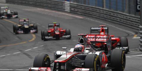 2012 Monaco Grand Prix: Jenson Button, McLaren MP4-27 Mercedes, leads Timo Glock, Marussia MR01 Cosworth, and Charles Pic, Marussia MR01 Cosworth.