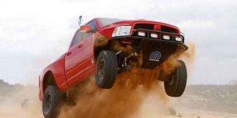 Automotive design, Automotive tire, Vehicle, Land vehicle, Sand, Automotive exterior, Landscape, Off-road vehicle, Motorsport, Fender,