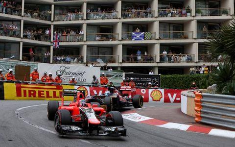 2012 Monaco Grand Prix: Charles Pic, Marussia MR01 Cosworth, leads Jean-Eric Vergne, Toro Rosso STR7 Ferrari.