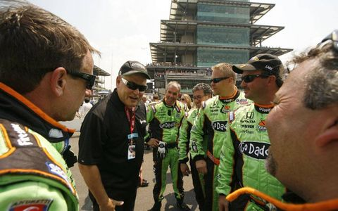 Go Daddy.com Founder and CEO Bob Parsons gives Danica Patrick's team a pep talk before the start of the race.