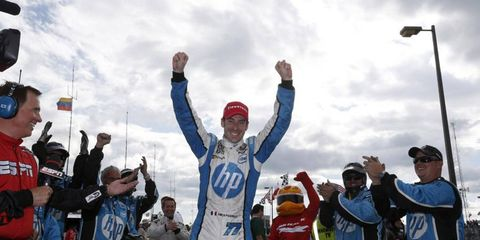 Simon Pagenaud celebrates after winning the second race of the Detroit Grand Prix.
