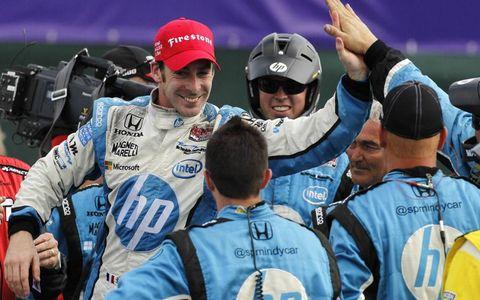 Simon Pagenaud celebrates with his team.