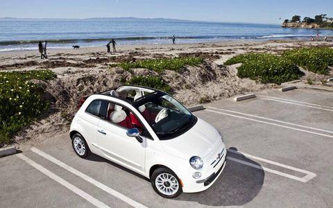 Motor vehicle, Tire, Wheel, Automotive design, Automotive mirror, Vehicle, Coastal and oceanic landforms, Land vehicle, Alloy wheel, Car,