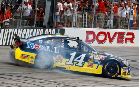 Tony Stewart finally broke through for his first NASCAR Sprint Cup win of the year on Sunday at Dover.