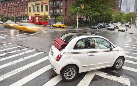 Tire, Motor vehicle, Wheel, Road, Mode of transport, Automotive design, Alloy wheel, Land vehicle, Vehicle, Yellow,
