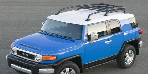 The 2007 FJ Cruiser draws heavily on familiar cues, lifting its oval grille housing almost wholesale from the 1967 FJ40 Land Cruiser. Within its metallic housing the head-lamps straddle a honeycomb grille, with the whole unit flanked by a pair of amber turn signals that curve around the corners. It's hard to miss the FJ's suicide-style back doors, extra-wide C-pillars and blacked-out rear windows. And from behind, those rear windows effect the look of a wraparound backlight by blending into the rear glass, only the frame for the hatch door disrupting the flow.  The FJ draws power from a 4.0-liter V6 familiar from its Tacoma and Tundra truck applications, and uses Toyota's signature VVT-i setup to help crank out 239 hp and 278 lb-ft of torque. Standing-starts are peppy; we estimate the rear-drive FJ is good for a sub-8.0-second 0-to-60-mph time.