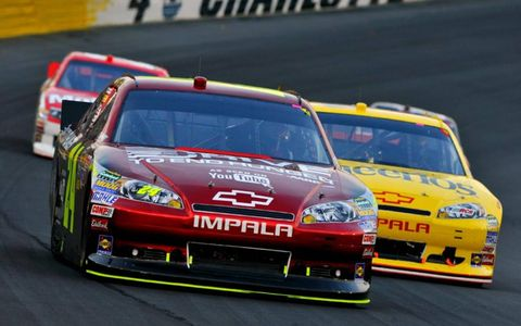 Jeff Gordon leads two cars around Charlotte Motor Speedway. Photo by: LAT Photographic