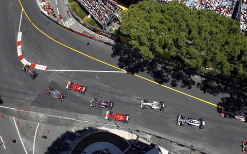 An overhead look as the field enters turn one at the start of the race. Photo by: Steven Tee/LAT Photographic