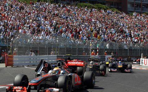 Jaime Alguersuari in his Scuderia Toro Rosso-Ferrari runs into Lewis Hamilton's McLaren to start a crash that lead to a red flag. Photo by: Glenn Dunbar/LAT Photographic