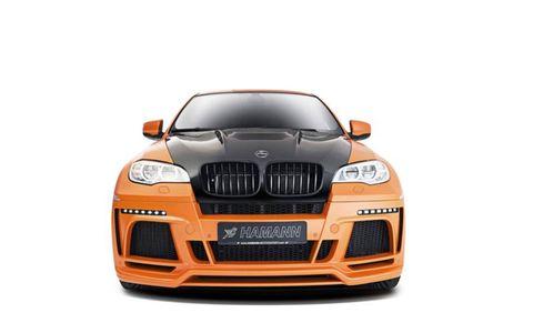 Motor vehicle, Automotive design, Product, Automotive exterior, Hood, Automotive lighting, Grille, Automotive mirror, Headlamp, Orange,