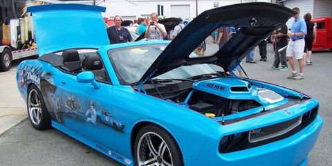 """Legacy by Petty, a one-of-a-kind Dodge Challenger custom built by Petty's Garage to pay tribute to """"The King"""" Richard Petty and to promote vehicle lift safety, is officially revealed during the inaugural Spring Fling Car Show held at Petty's Garage on May 28. The show was sponsored by the Automotive Lift Institute (ALI) and its members."""