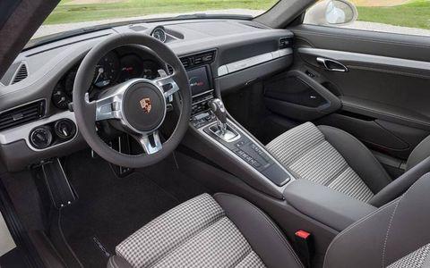 The interior features Pepita tartan-design seats and matching decorative panels