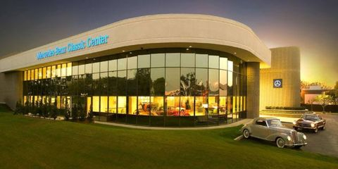 Commercial building, Facade, Real estate, Classic car, Antique car, Mixed-use, Luxury vehicle, Classic, Vintage car, Lawn,