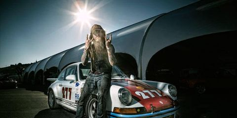 Magnus Walker poses with his 1971 Porsche 911.