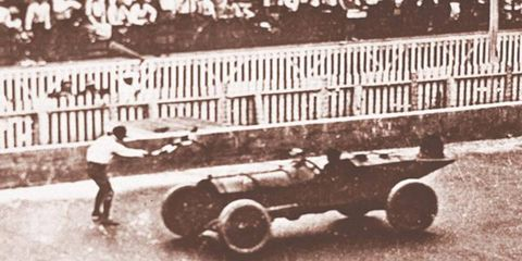 Speedway management decides to run just one major event for 1911, rather than multiple races over several days. Forty cars, mostly stripped-down passenger vehicles, line up to start the first Indy 500. Ray Harroun, in a purpose-built Marmon Wasp, wins the race in 6h 42m, averaging 74.602 mph.